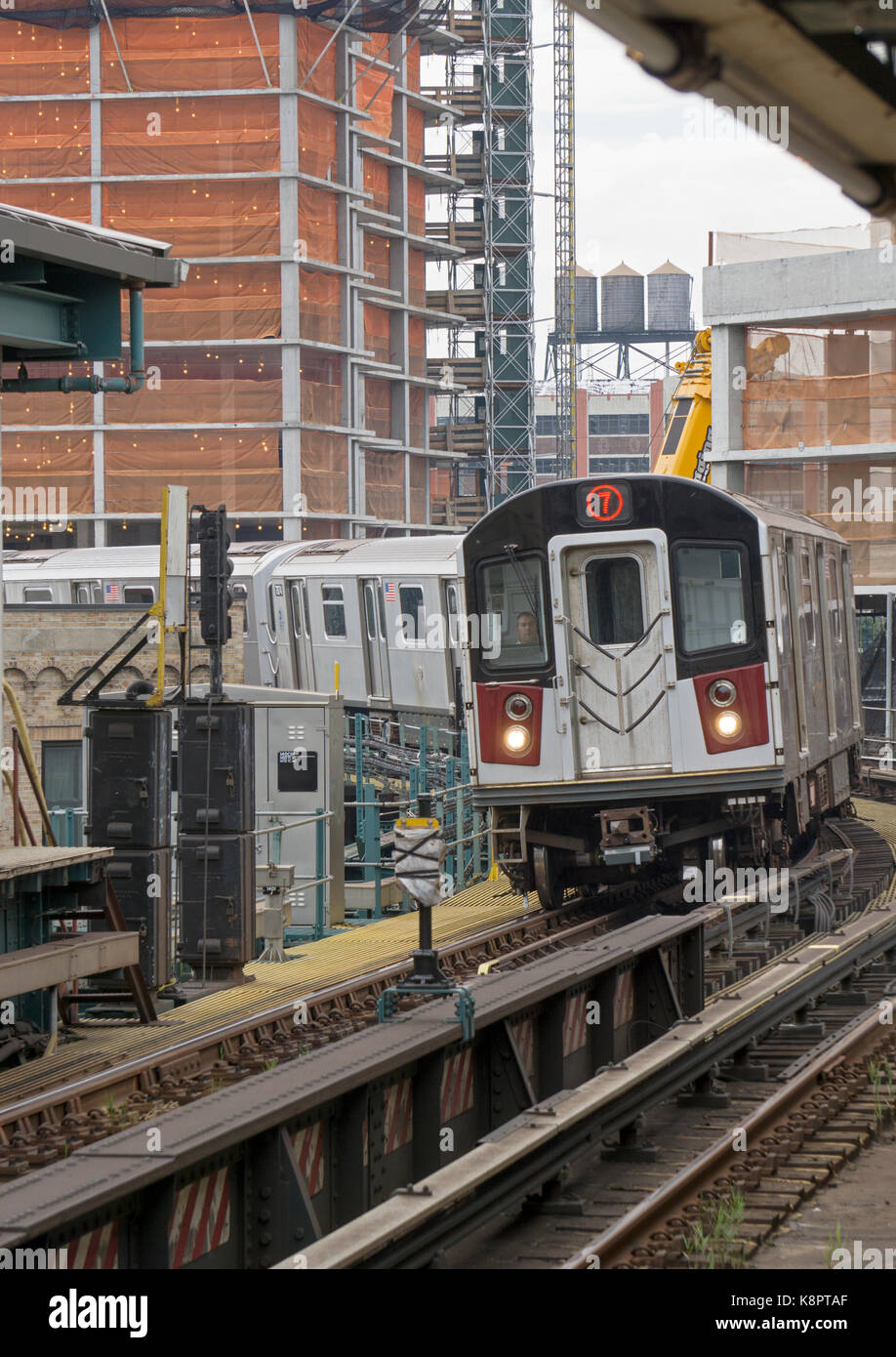 The Queens bound #7 elevated subway train pulling into the 45th Road-Courthouse Square station in Long Island City - Stock Image