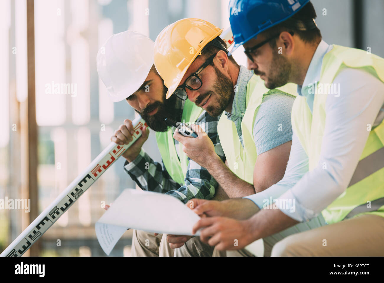 Portrait of construction engineers working on building site - Stock Image
