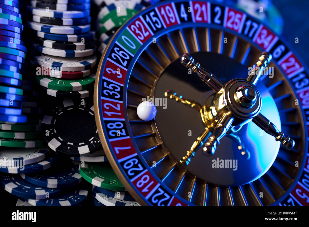 Casino theme. Roulette and stacks of chips. - Stock Image