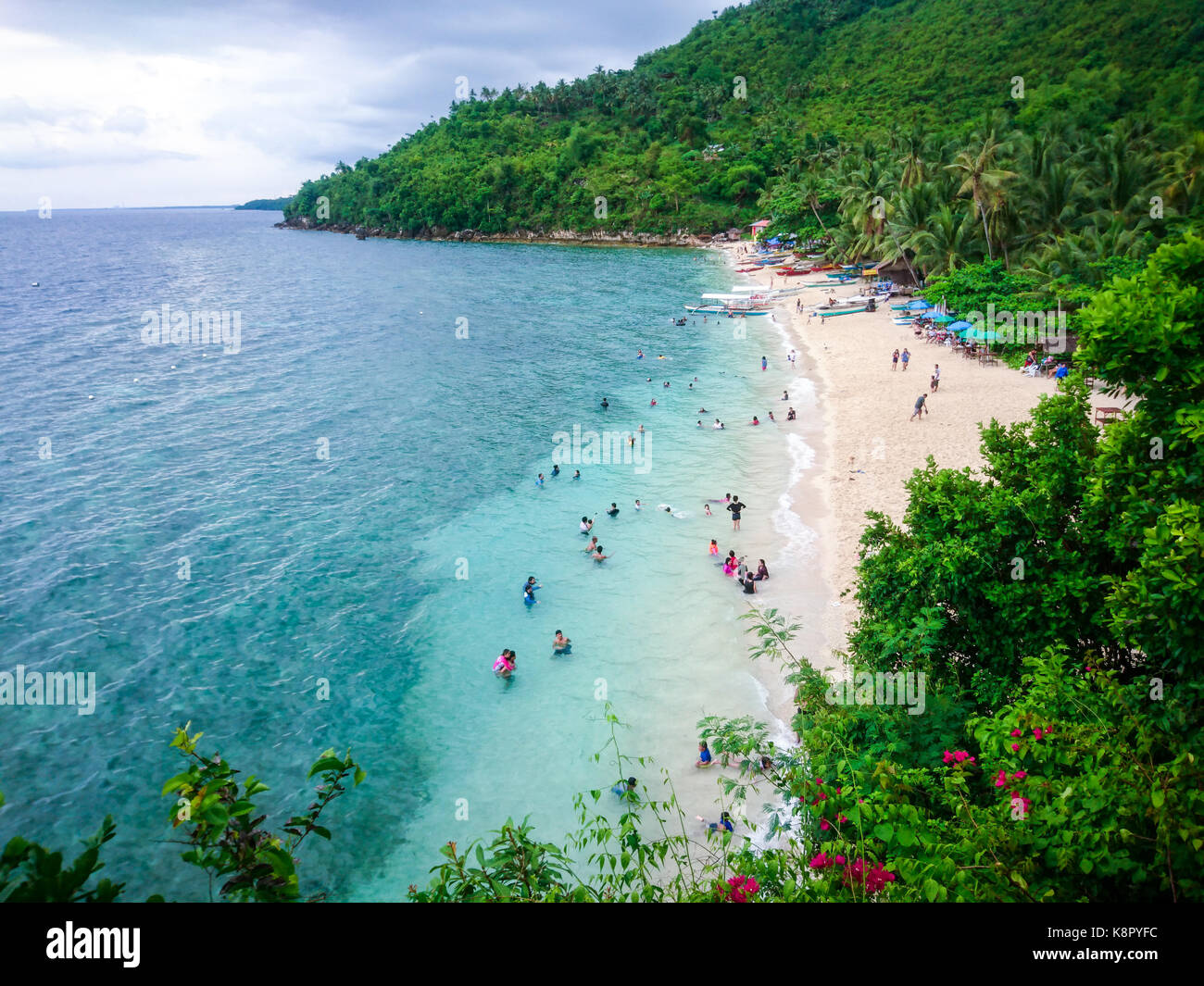 The clear blue waters and white fine sand beach in Hermit's Cove, Aloguinsan, at the southern part of Cebu, - Stock Image