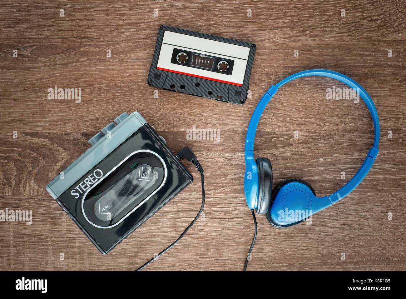 Vintage walkman, cassete and headphones. - Stock Image