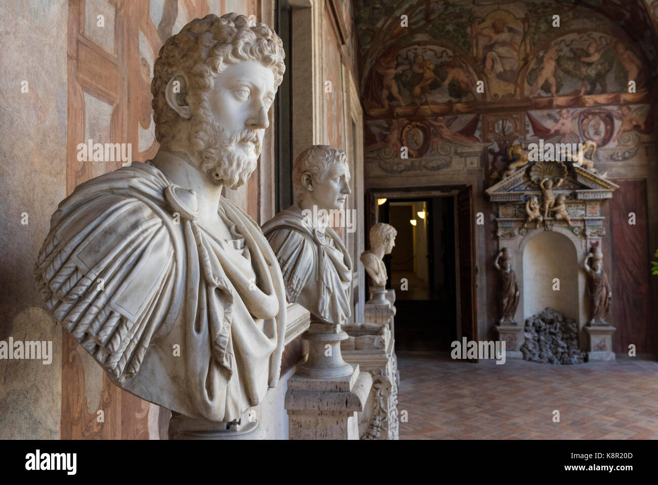 Rome. Italy. Busts of Roman Emperors, (foreground) Emperor Marcus Aurelius, line the loggia of Palazzo Altemps. - Stock Image