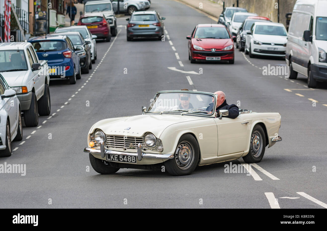 White convertible Triumph TR$ Cabriolet sports car from 1964 in the UK. Open top classic car in the UK. - Stock Image
