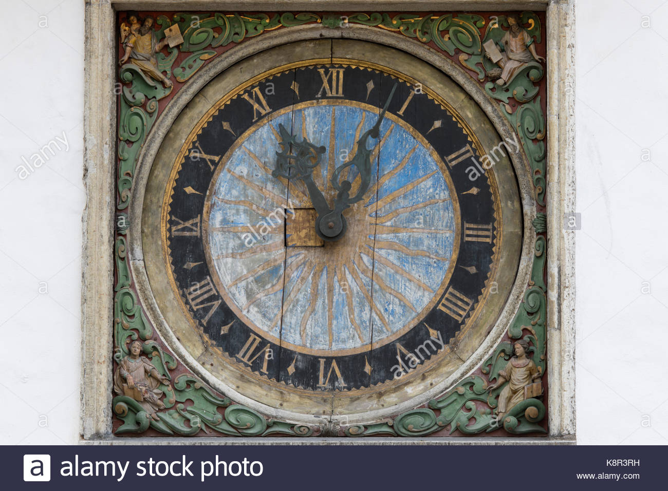 17th century clock with golden sun motif on facade of the Church of the Holy Ghost, Old Town, Tallinn, Estonia, - Stock Image