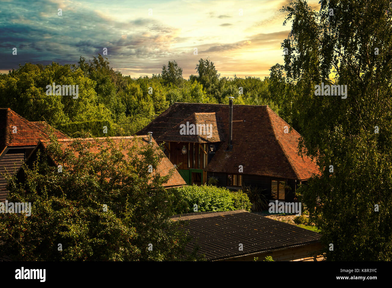 A cosy Kentish home, Edgerton, Kent. Barn converstion at sunset, cosy living - Stock Image