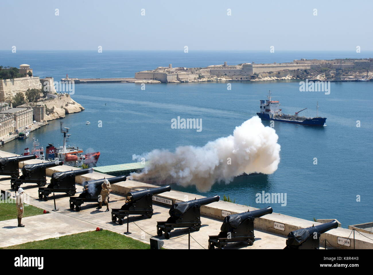 Cannon being fired at noon at the Saluting Battery, Upper Barracca Gardens, Valletta, Malta - Stock Image