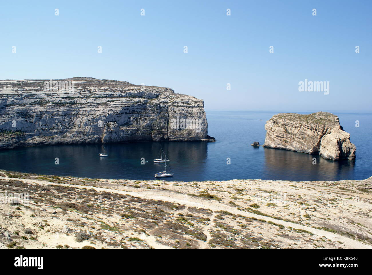 Sailing yachts at anchor in Dwejra bay, San Lawrenz, Gozo, Malta - Stock Image