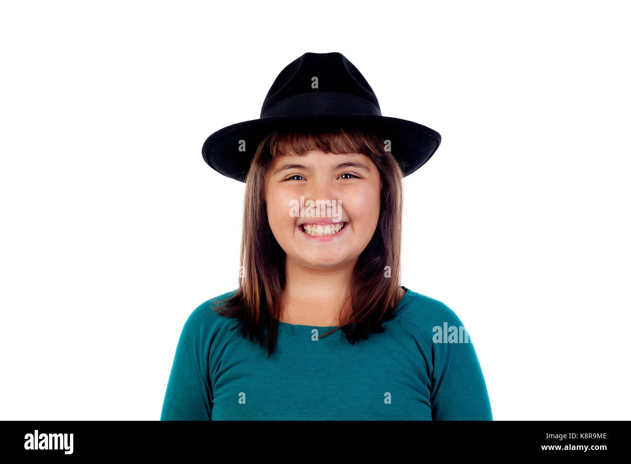 Adorable small girl with black hat isolated on a white background Stock Photo
