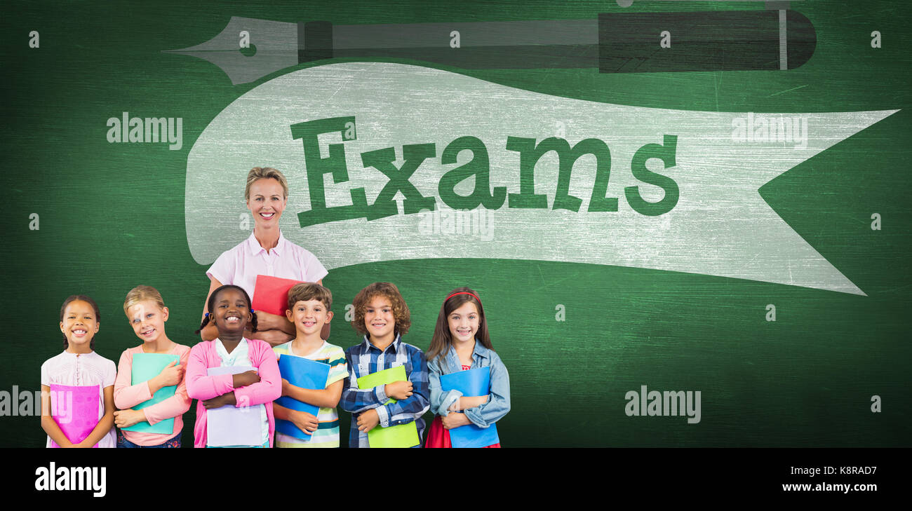 Portrait of students with teacher holding files against exams against green chalkboard - Stock Image