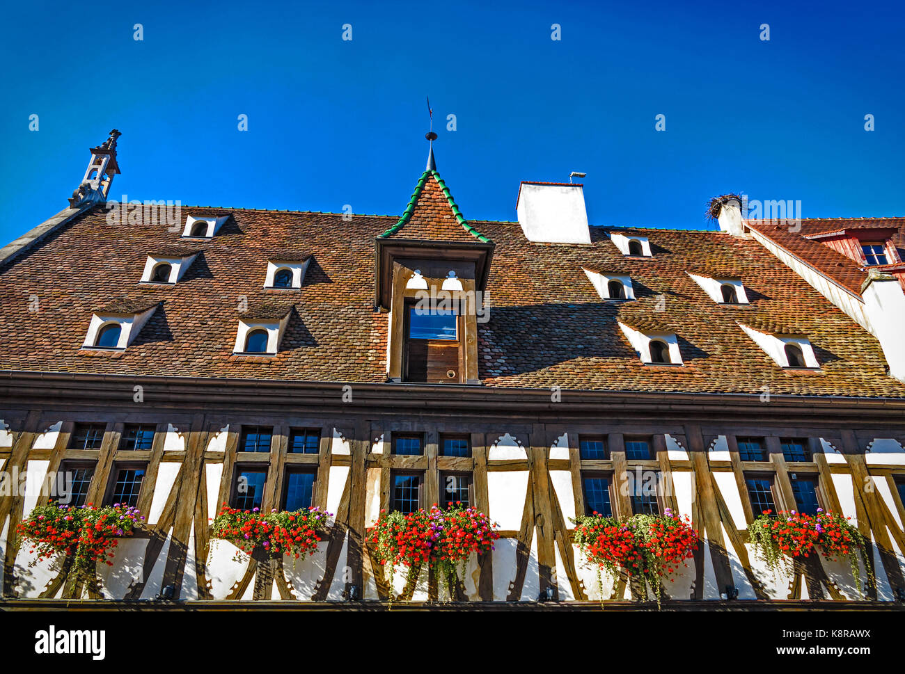 Picturesque historic Renaissance-style the Hall aux Blés granary in Obernai, near Strasbourg, France - Stock Image