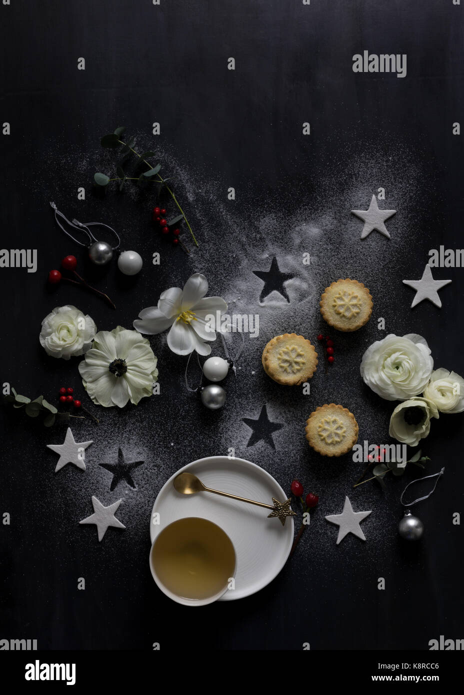 View from above of Christmas tree made of decorations, berries, cinnamon, candles and other festive objects - Stock Image