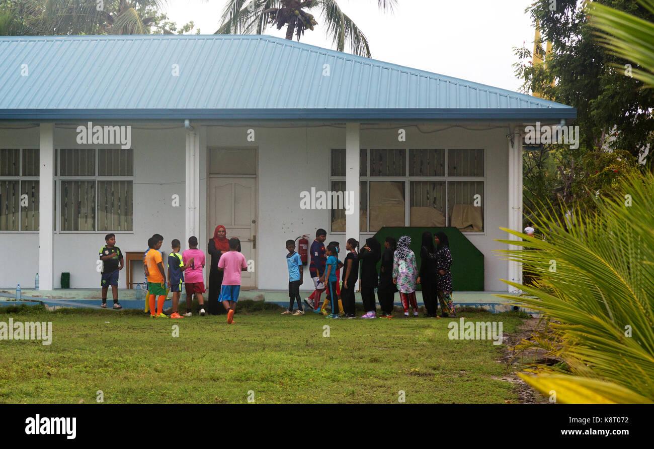 Maldives school - schoolchildren and their teacher, the Village school, Rasdhoo Island, the Maldives Asia - Stock Image