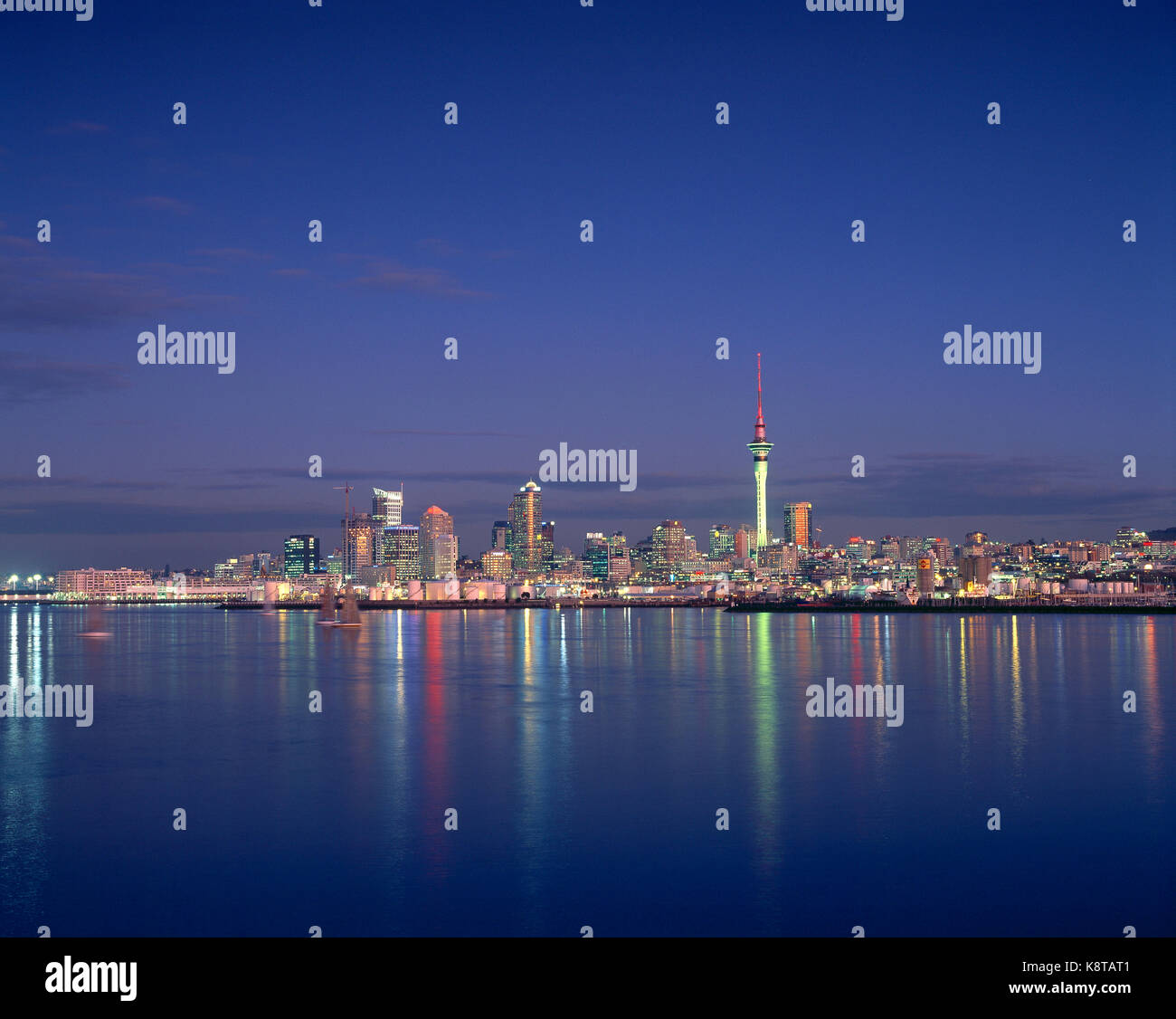New Zealand. Auckland. City skyline from across the water at night. - Stock Image
