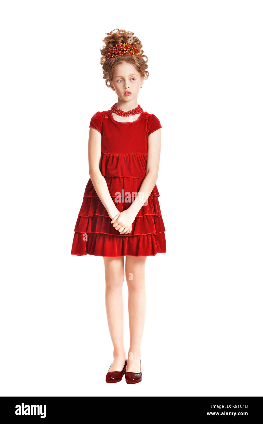 48079e67e504 Cute little girl in red velvet dress with retro hairstyle isolated on white  background