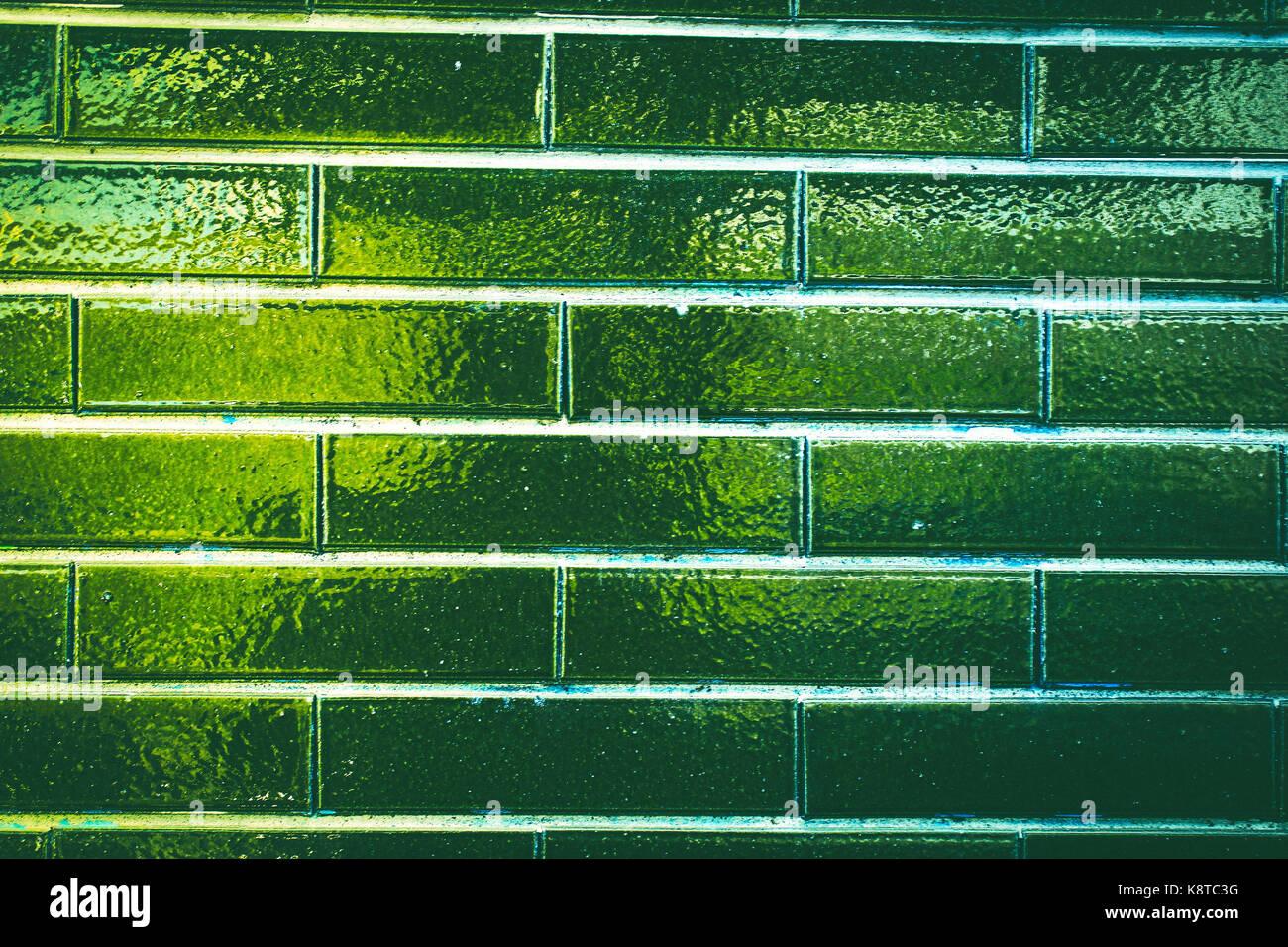 shiny green brick wall Stock Photo