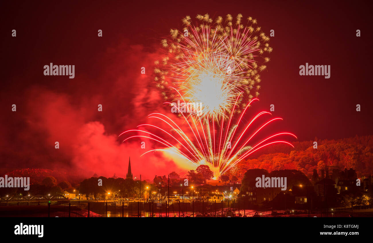 Kirkcudbright, Tattoo, Fireworks, Display, 2017,Boats, Harbour, Star bursts, mudflats, Church, red colour, Harbour - Stock Image