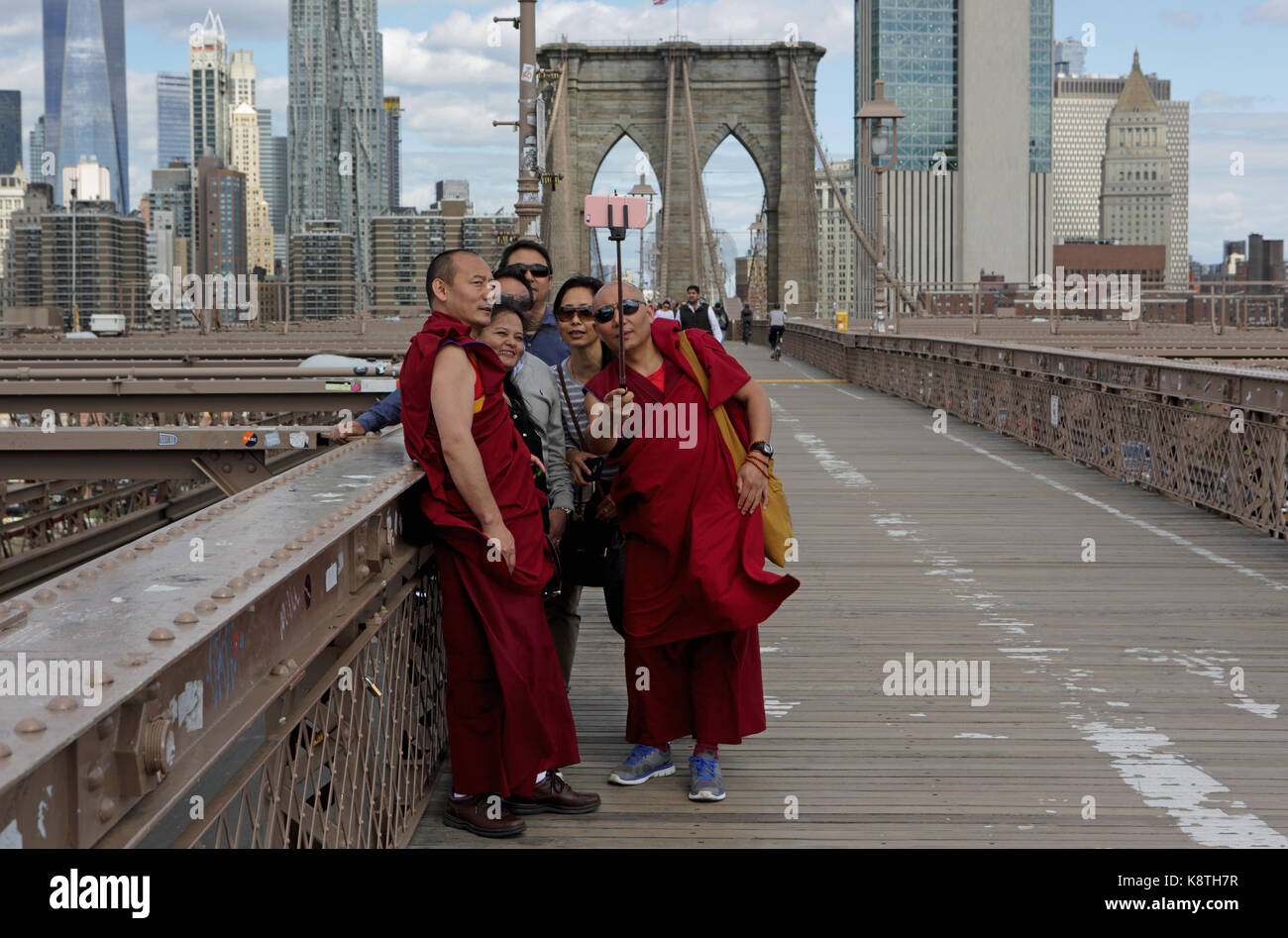 New York, NY, USA - May 3, 2017: Group of Asian people and Buddhist monks in traditional robes take a selfy photo - Stock Image