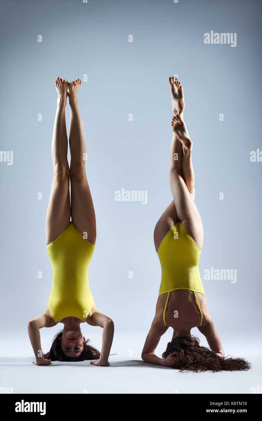 Two Young Women Doing Yoga Asana Supported Headstand Salamba Stock Photo 160353900 Alamy