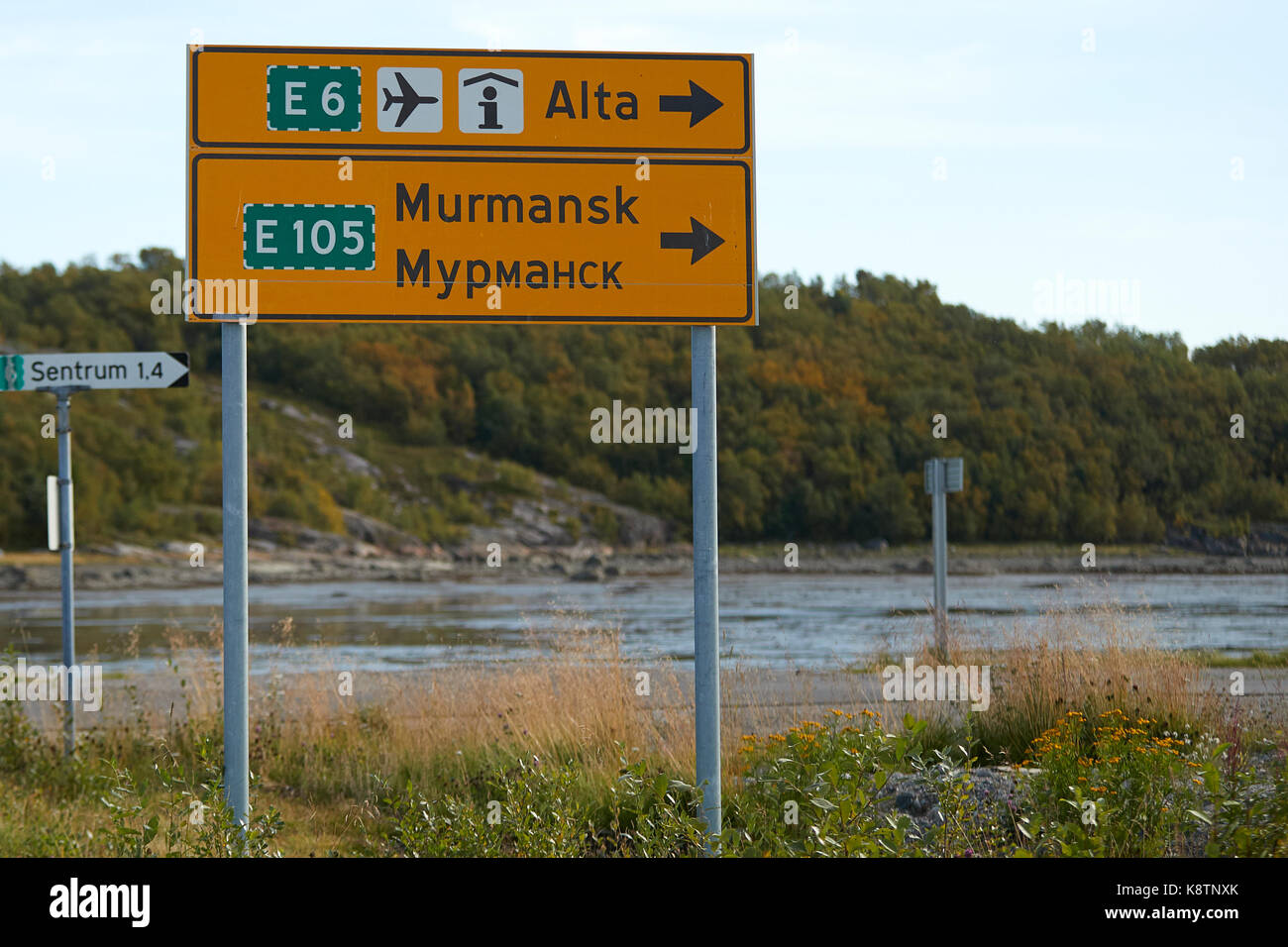 Norwegian Road Sign In Both The Latin And Cyrillic Alphabet, With Directions To Murmansk. - Stock Image