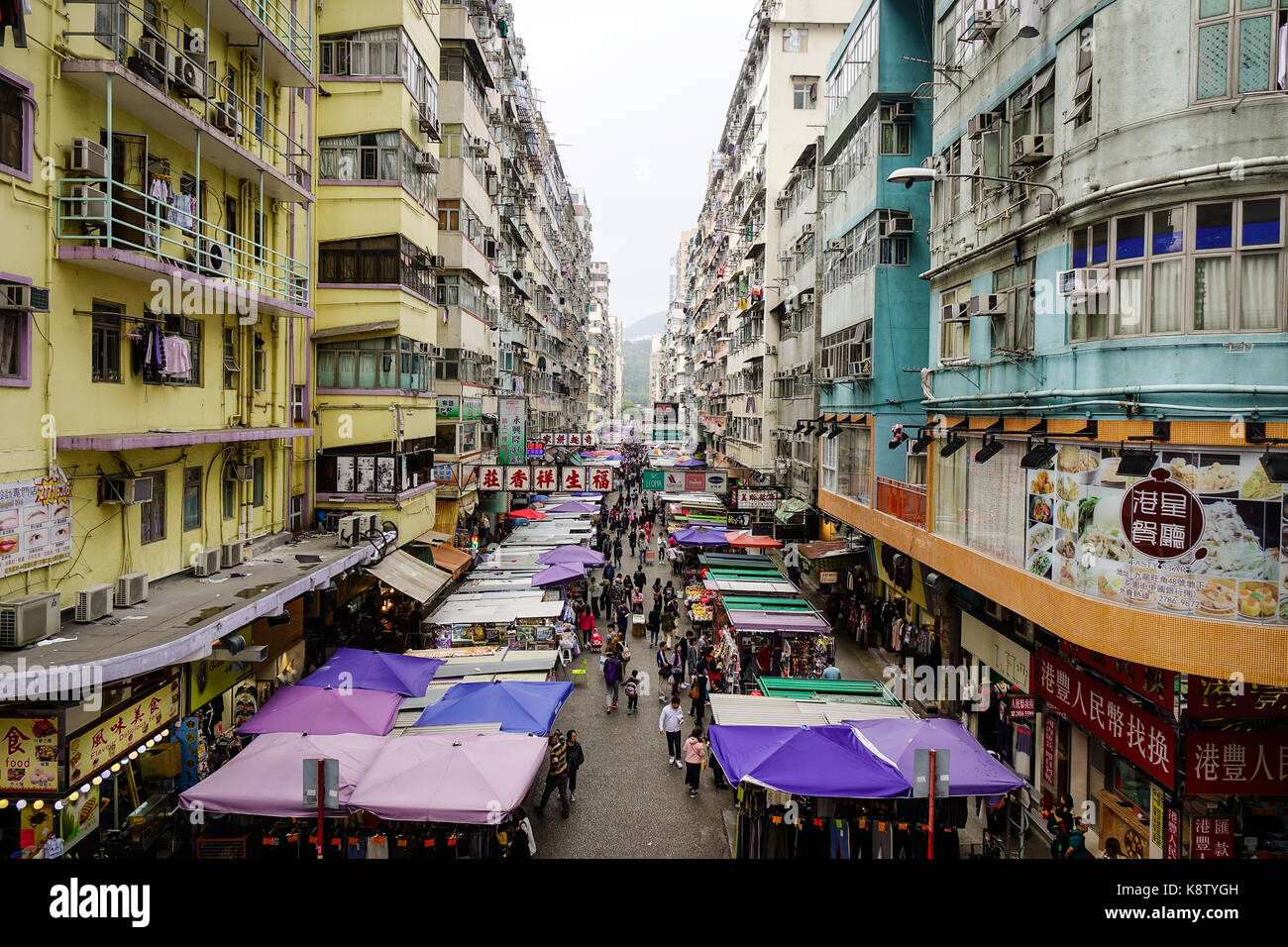 Hong Kong - Mar 29, 2017. People at Fa Yuen street market in Hong Kong. The area is popular with tourists and locals - Stock Image