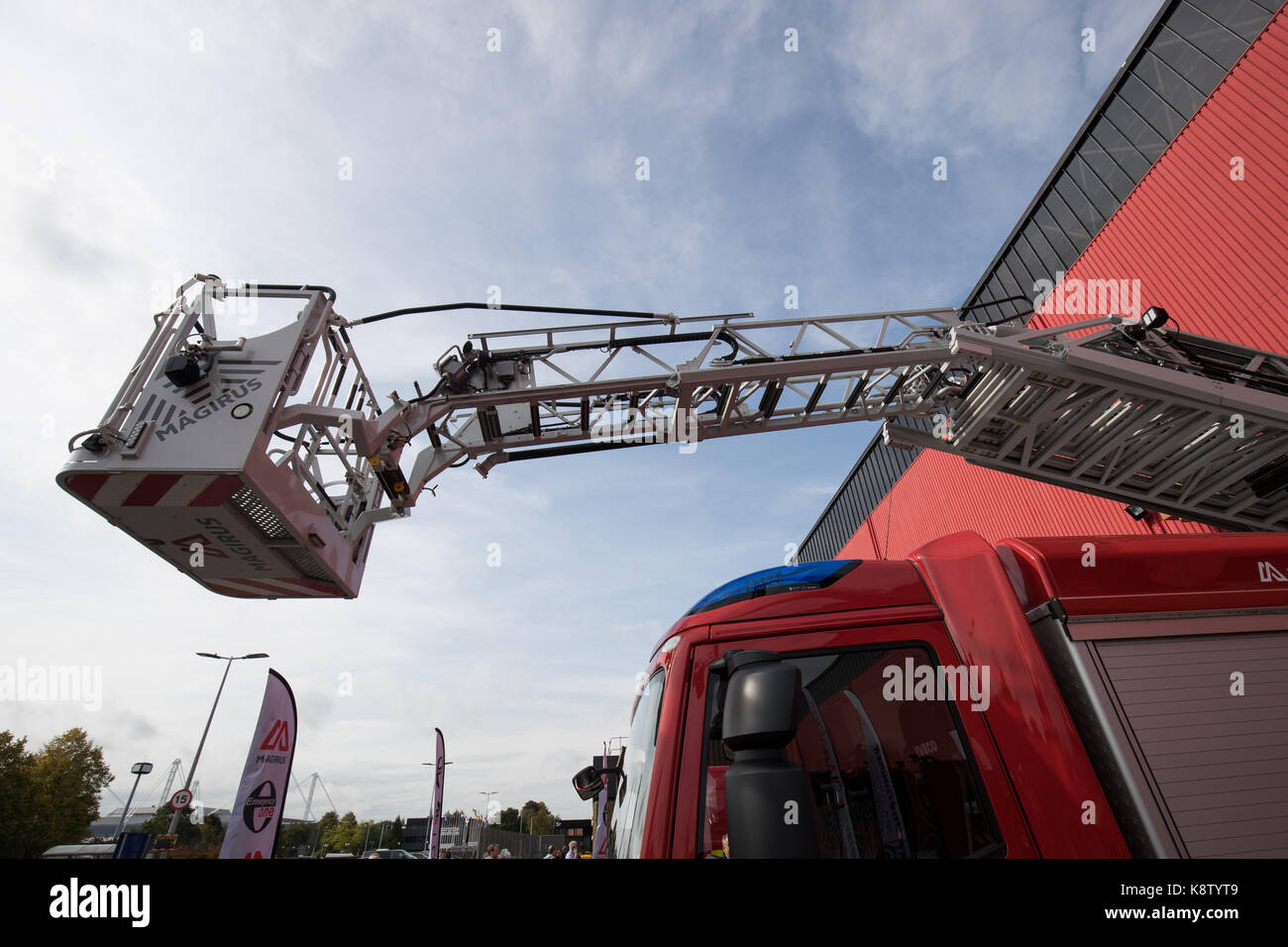 Emergency One/Clan Tools M32L-AT turntable ladder featuring a telescopic five section ladder with 32 metre working - Stock Image