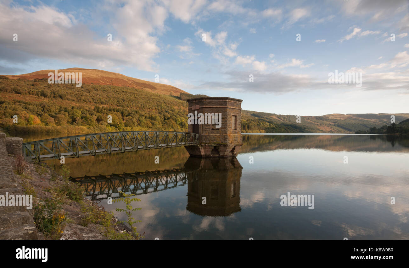 Talybont Reservoir and Pump House in autumn, in the Brecon Beacons, Wales, UK - Stock Image