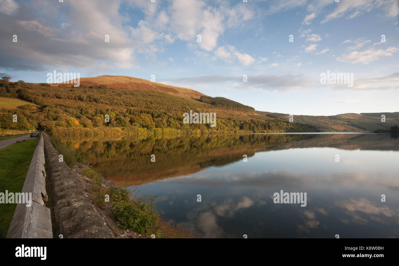 Talybont Forest overlooking Talybont on Usk Reservoir, in the Brecon Beacons, Wales, UK - Stock Image