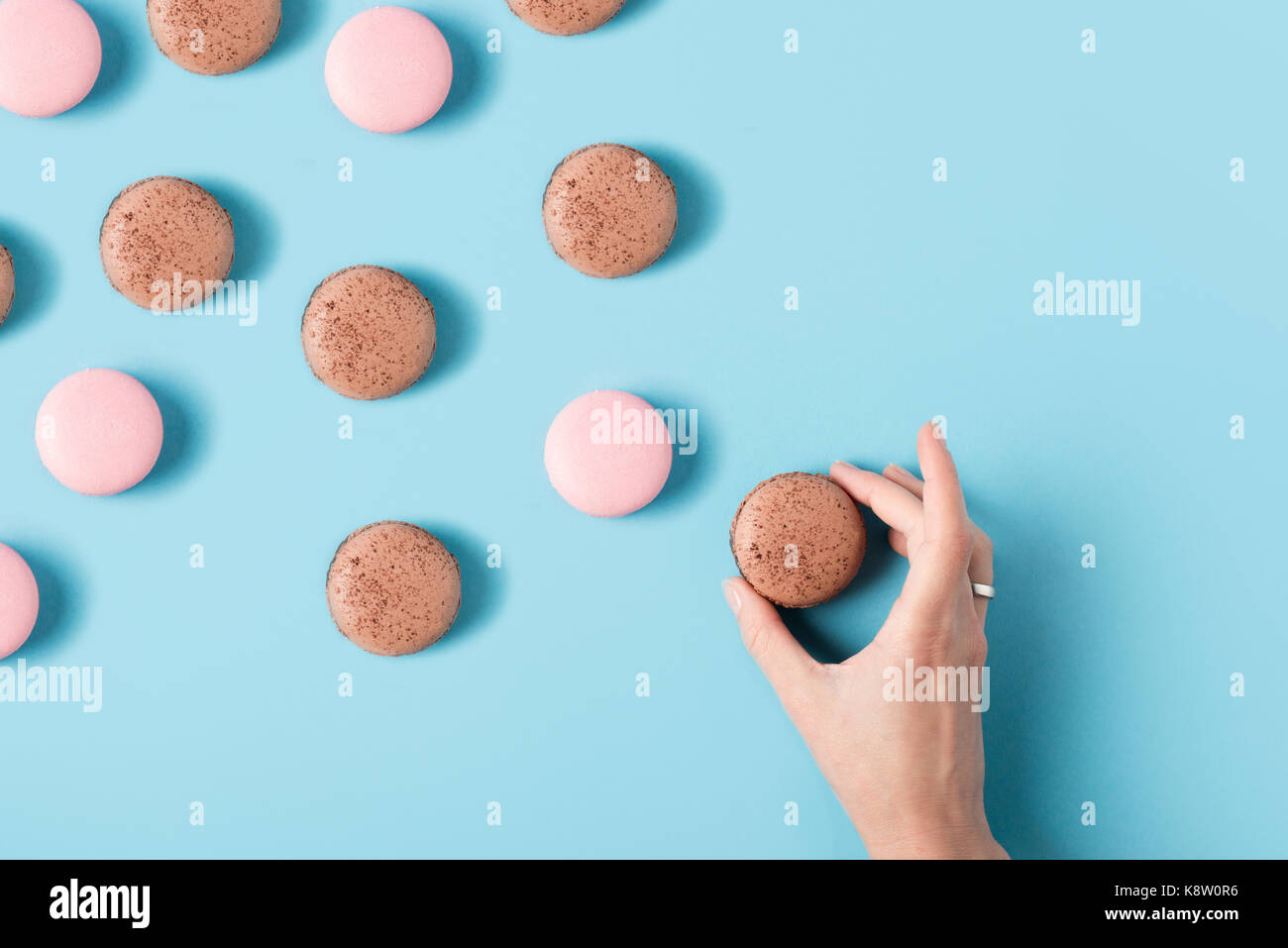 female hand and macarons - Stock Image