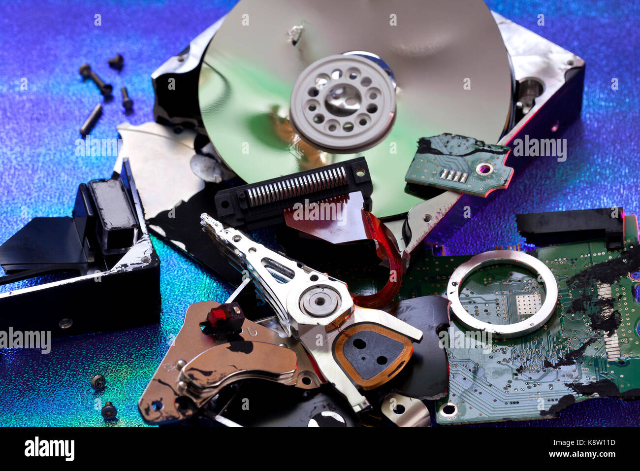 Parts of destroyed computer hard disk drive (HDD exploded view, HDD destroy) - USA - Stock Image