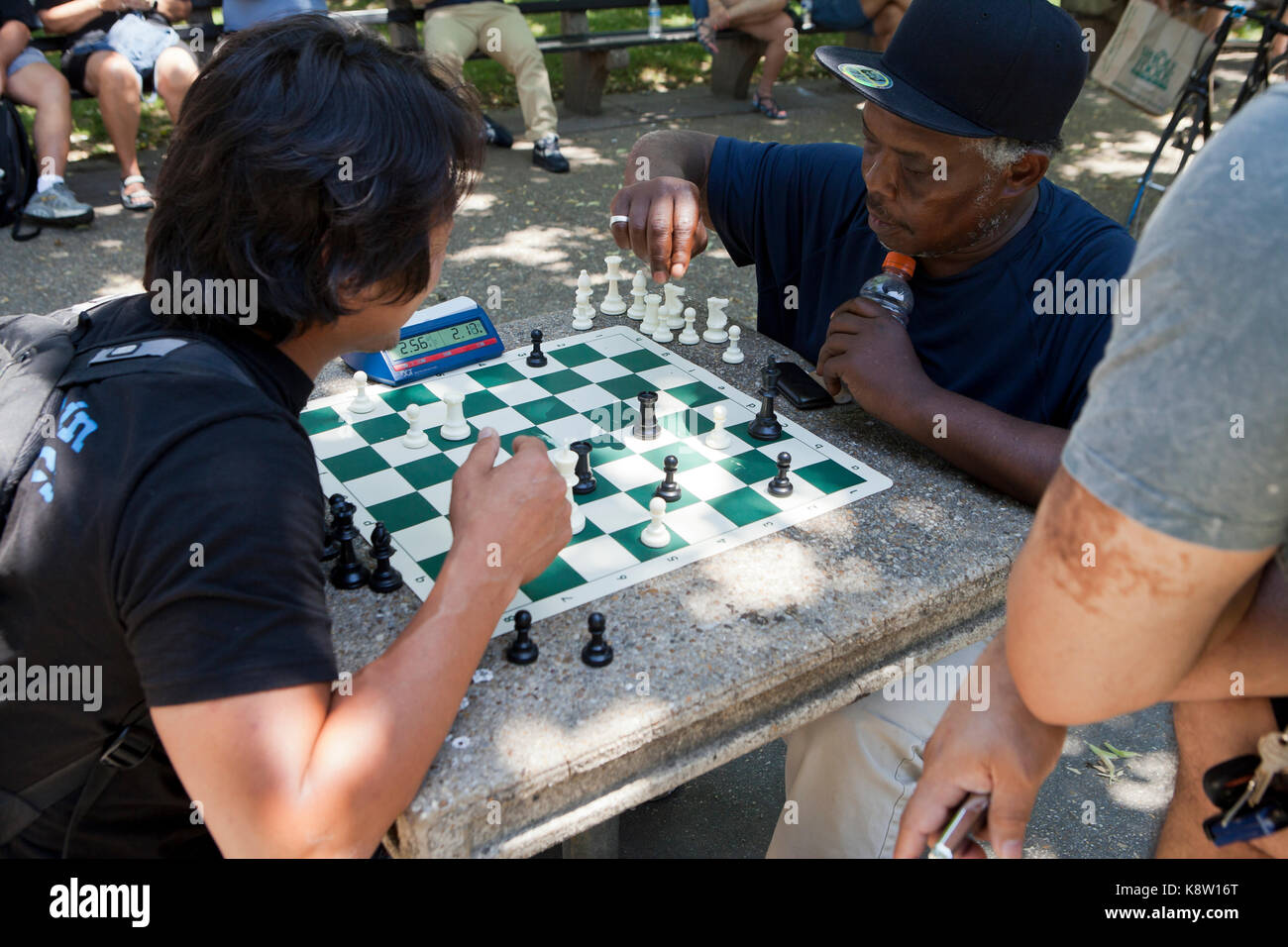 Men playing chess outdoors in a park at Dupont Circle - Washington, DC USA - Stock Image