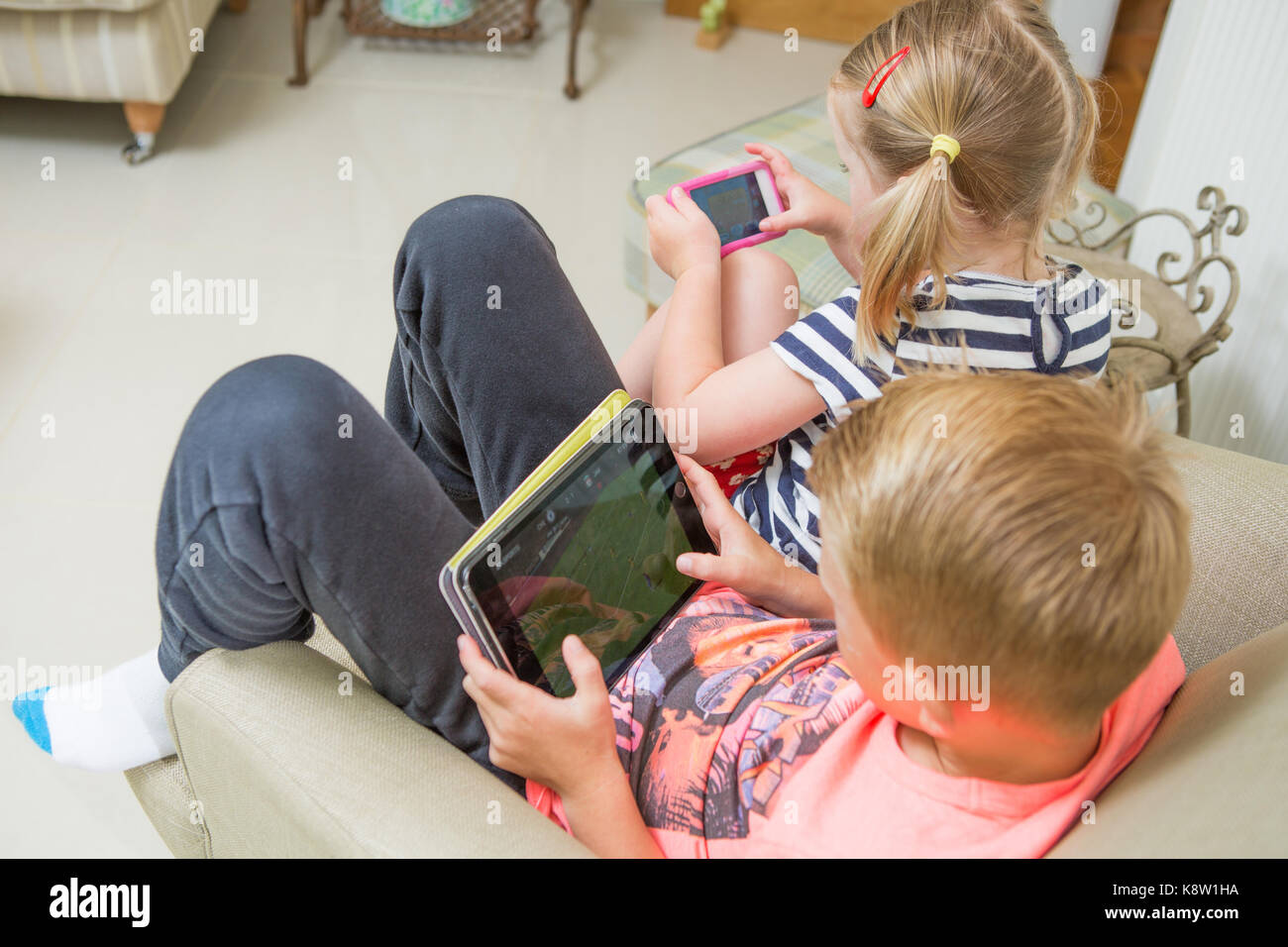 children using technology for gaming - Stock Image