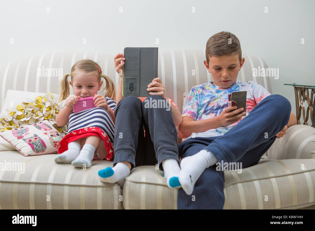 children using technology for gaming - Stock Image