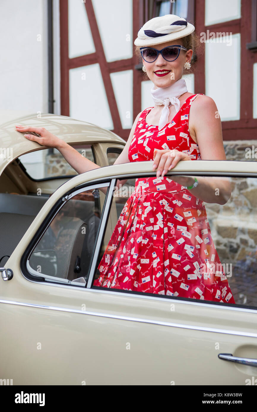 Elisabeth Weule from Stuttgart, Germany, is presenting her Volkswagen Beetle, Type 1, at classic car exhibition - Stock Image