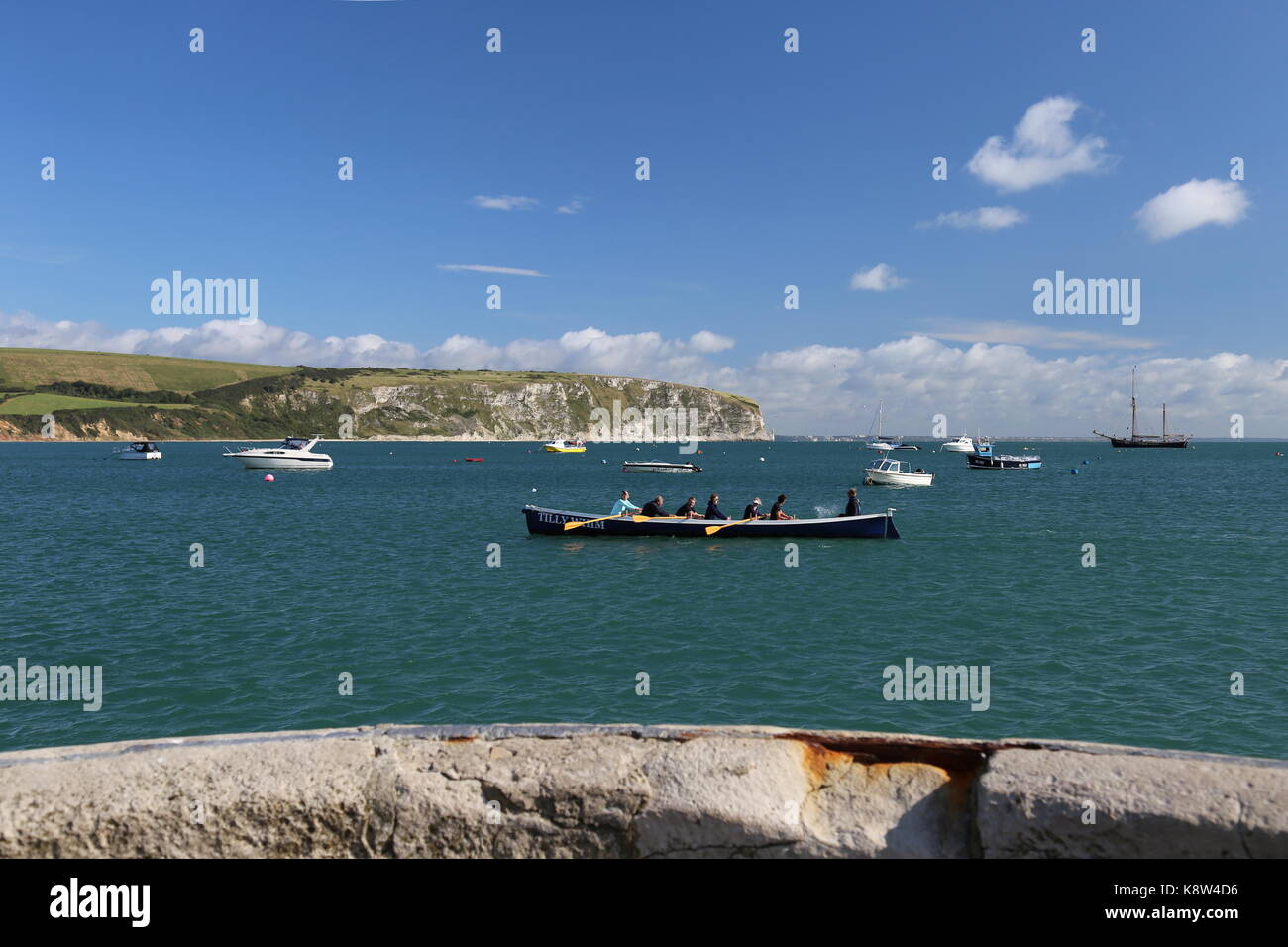 Swanage Sea Rowing Club 'Tilly Whim' pilot gig in Swanage Bay, Swanage, Isle of Purbeck, Dorset, England, - Stock Image