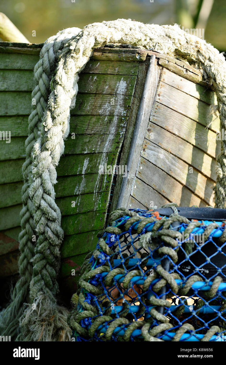 a rotten old wooden boat left out in the weather to rot. Stock Photo