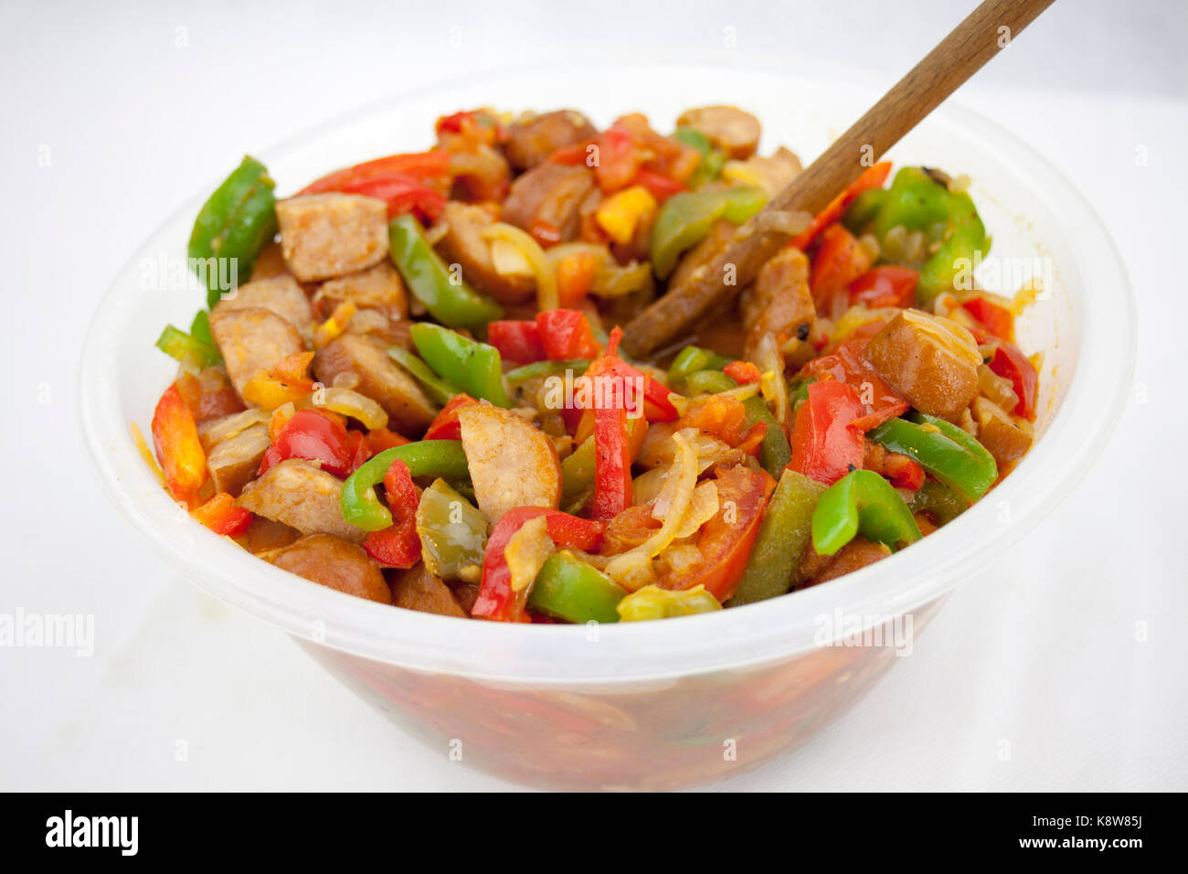 Delicious red souse from sausage, pepper and courgette in the ja - Stock Image