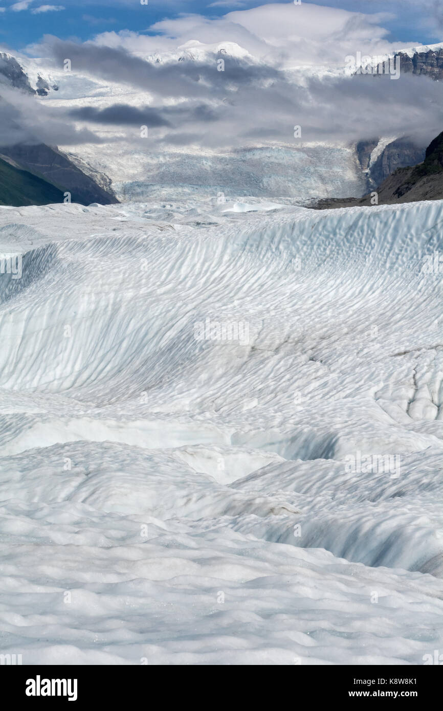 Melting ice carved channels into Root Glacier which point to the 7000 foot Stairway Icefall. - Stock Image