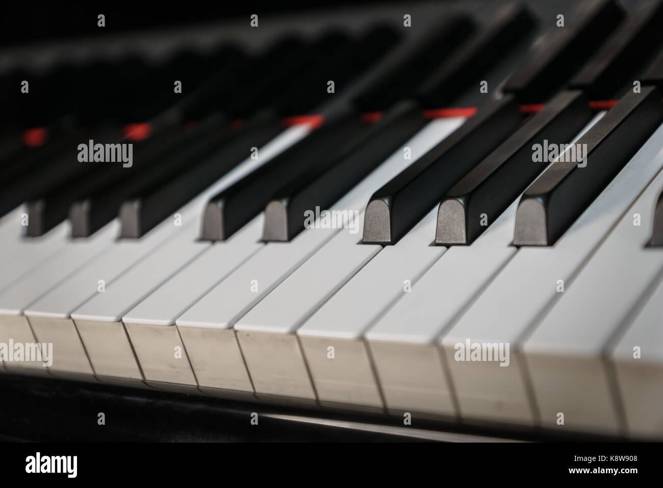 Piano keys on black classical grand piano play - Stock Image