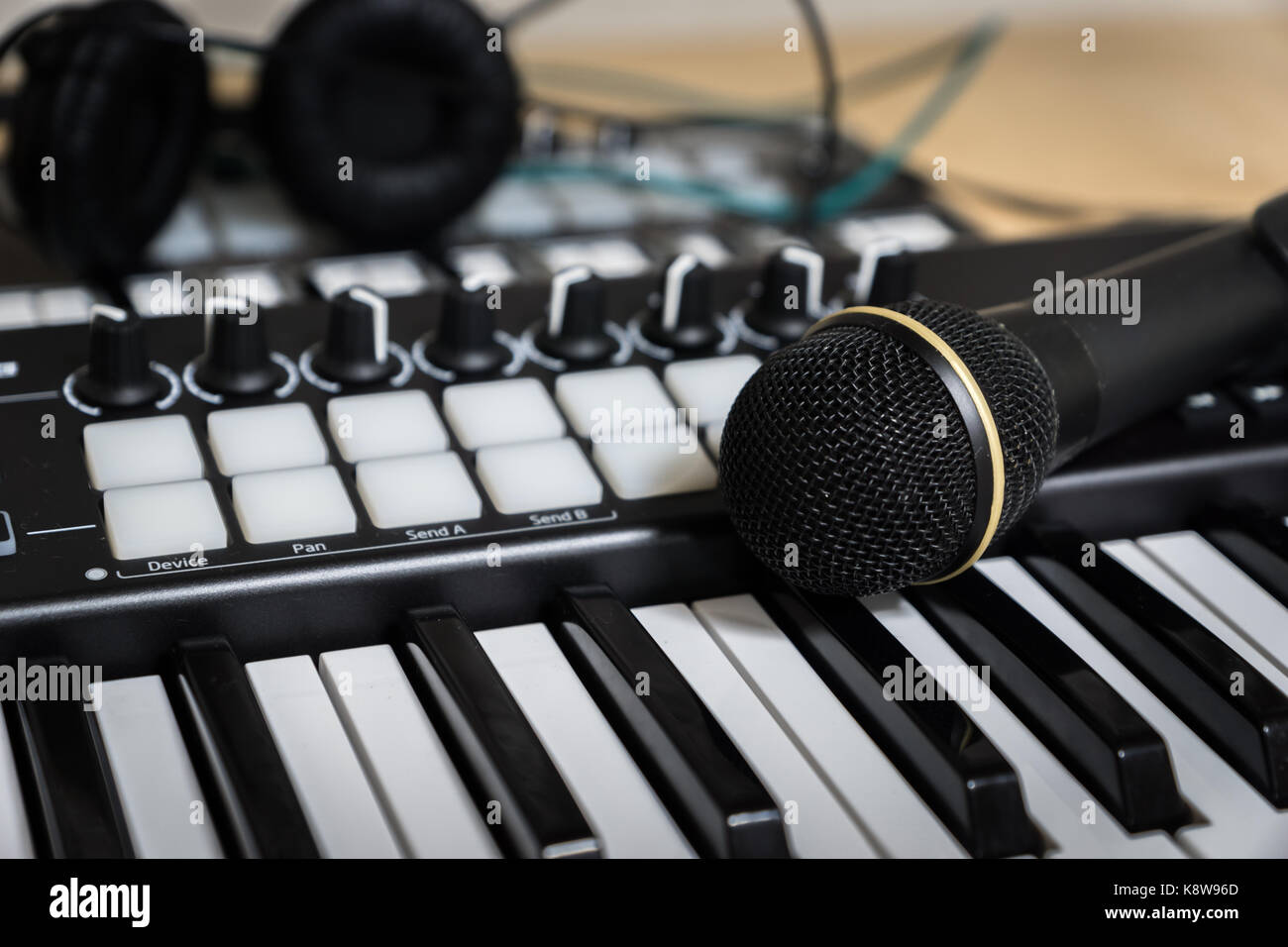 midi keyboard / midi controller and microphone , electronic musical synthesizer for EDM music production - Stock Image