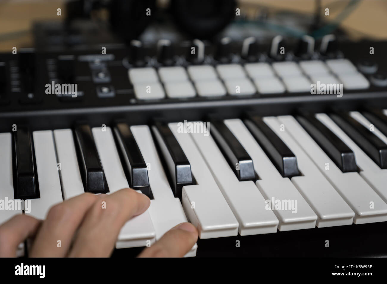 MIDI keyboard synthesizer piano keys closeup for electronic music production / recording - Stock Image