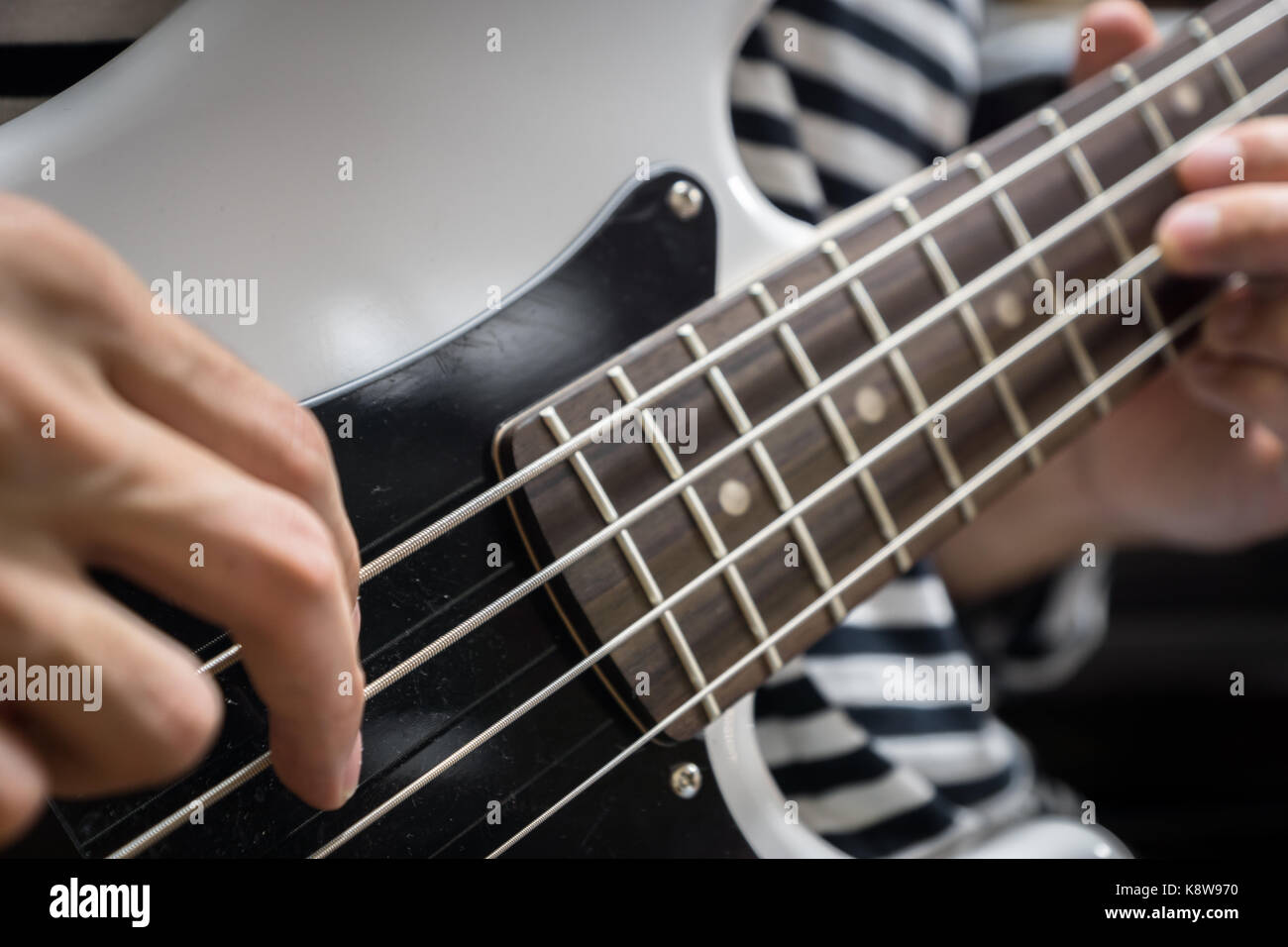 bass guitar finger style closeup - musical instruments - concept musical composition and creativity - Stock Image