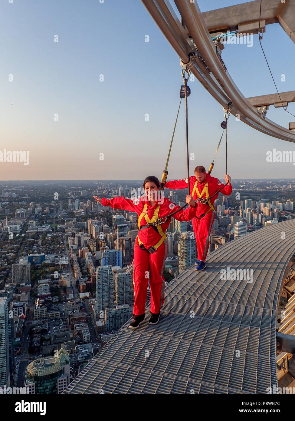 Toronto Canada Real People Doing The Edgewalk At The Cn Tower In Stock Photo Alamy