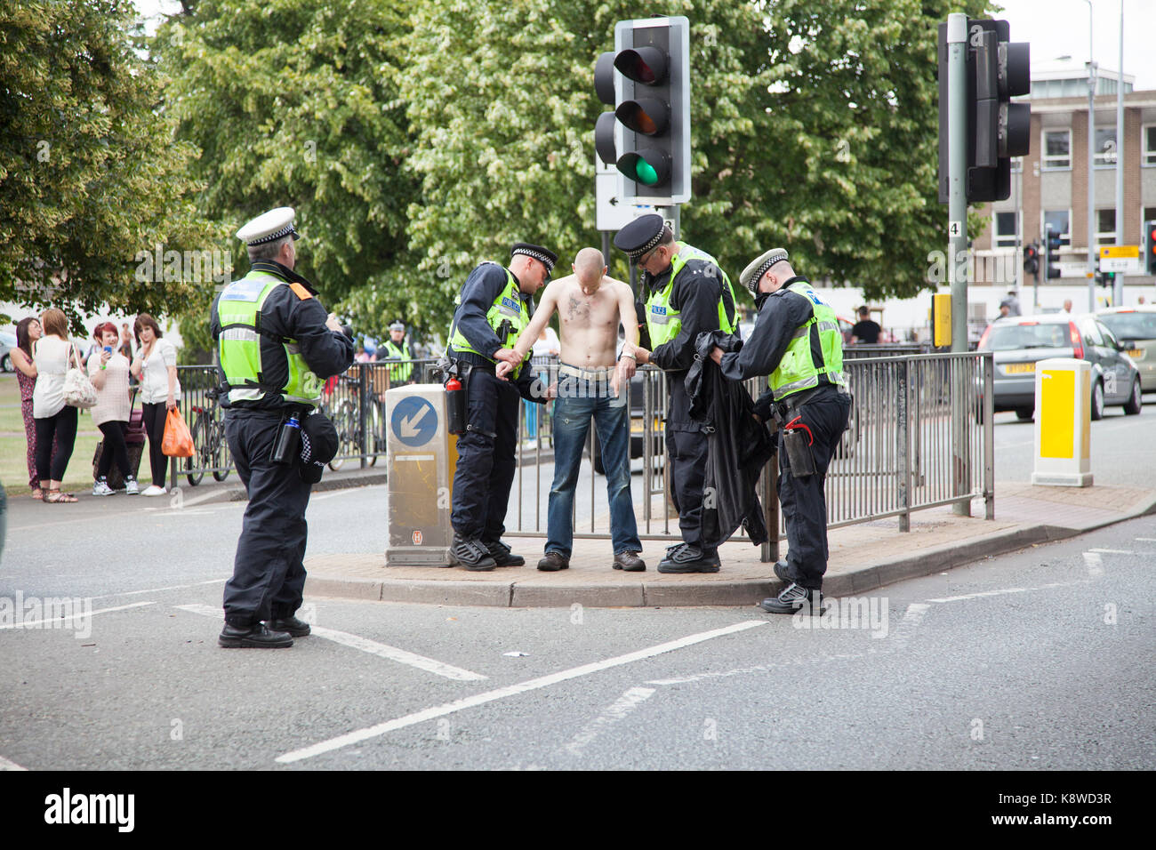 Police stop and search a male in Cambridge. - Stock Image