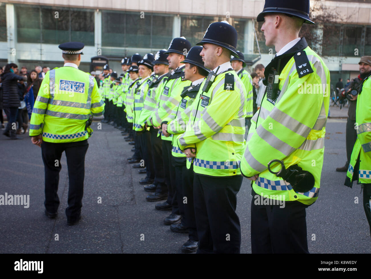 Metropolitan police and the public during an anti-austerity march. - Stock Image