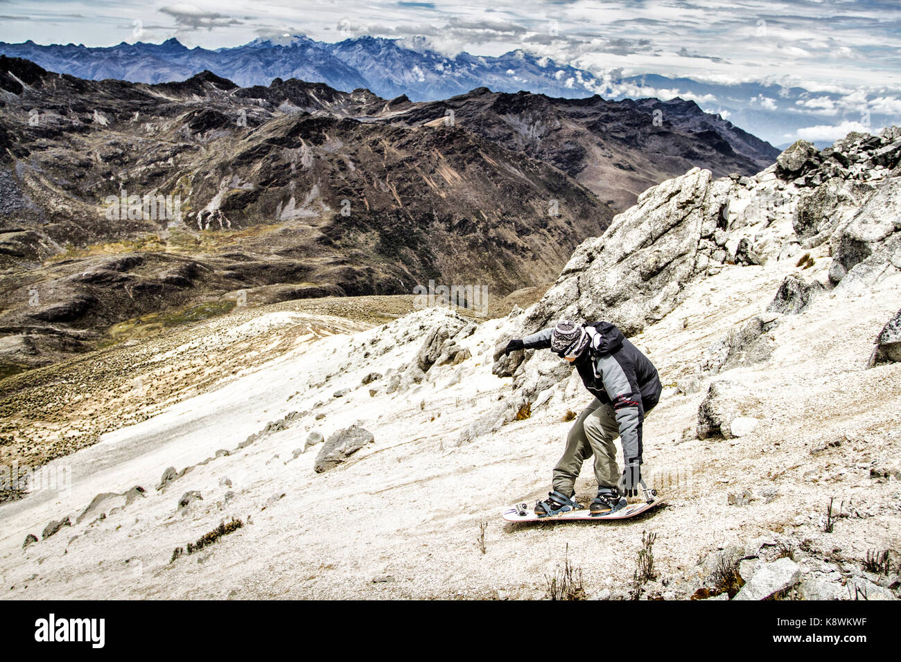 Sandboarding on the summit of Pico Pan de Azucar, the highest place to practice sandboard in the world (4,680 meters). - Stock Image