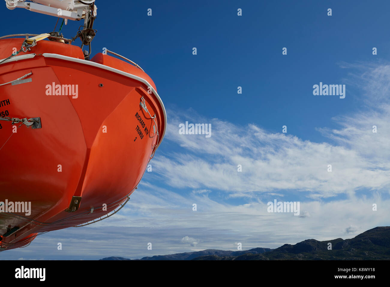 Abstract View Of A Lifeboat Suspended From Davits On The Hurtigruten Passenger Ship, MS Richard With, Sailing Along Stock Photo