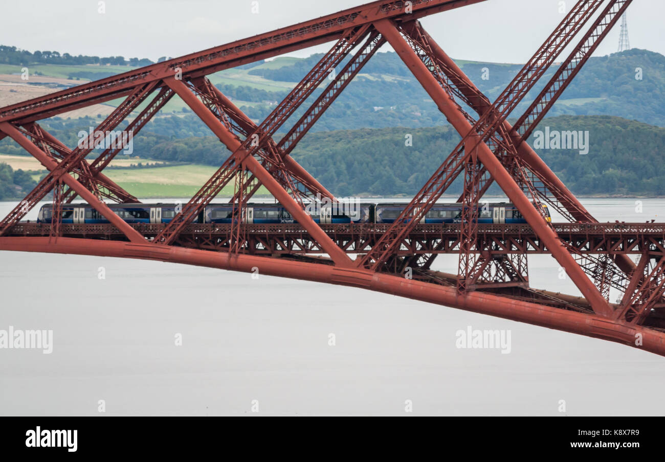 Zoomed view of a ScotRail train on cantilever Forth Rail Bridge over Firth of Forth, Scotland, UK - Stock Image