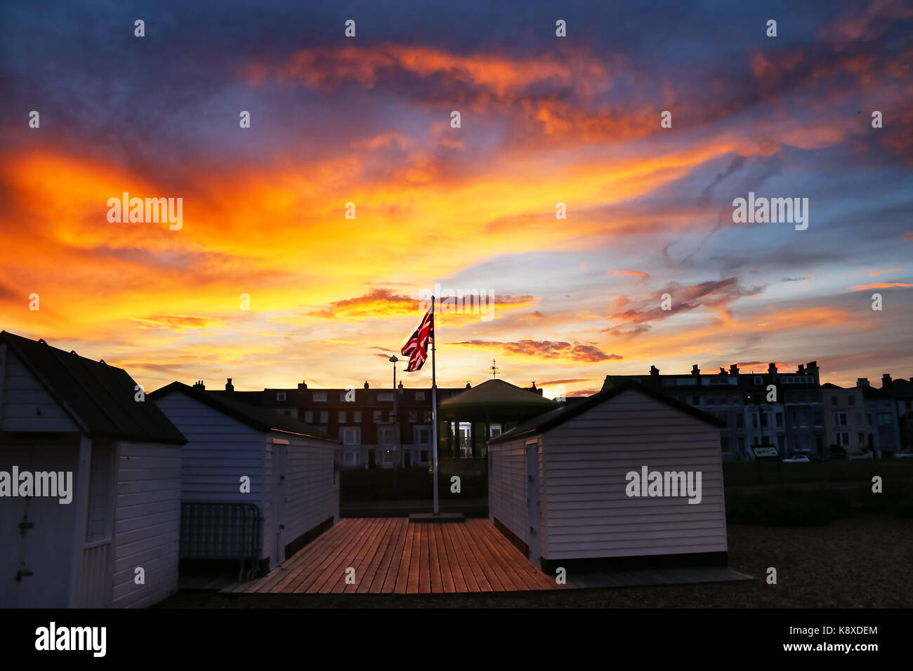 Walmer Bandstand, huts and Union Jack at sunset - Stock Image