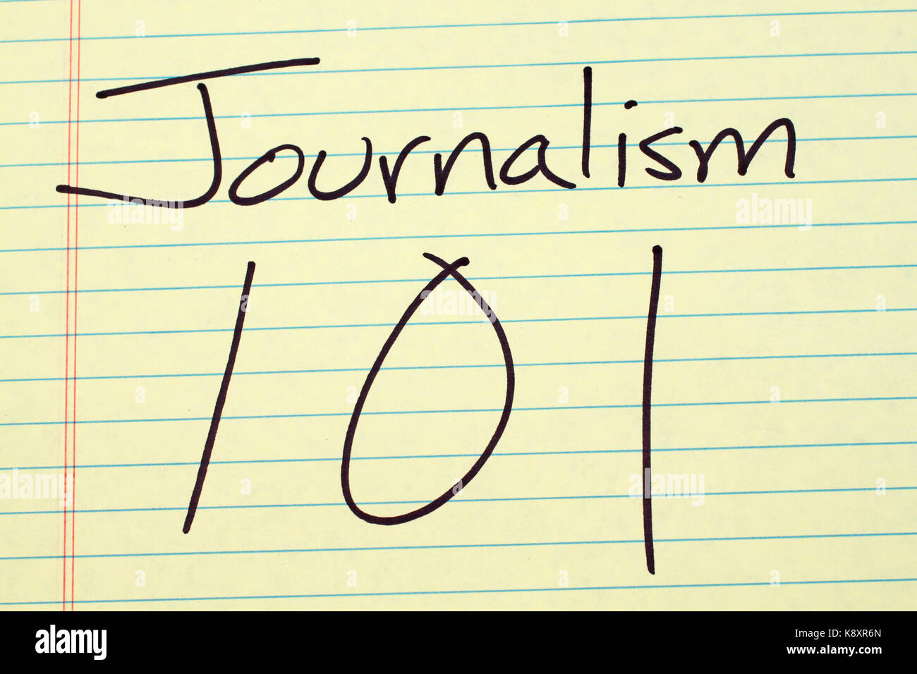 The words 'Journalism 101' on a yellow legal pad - Stock Image