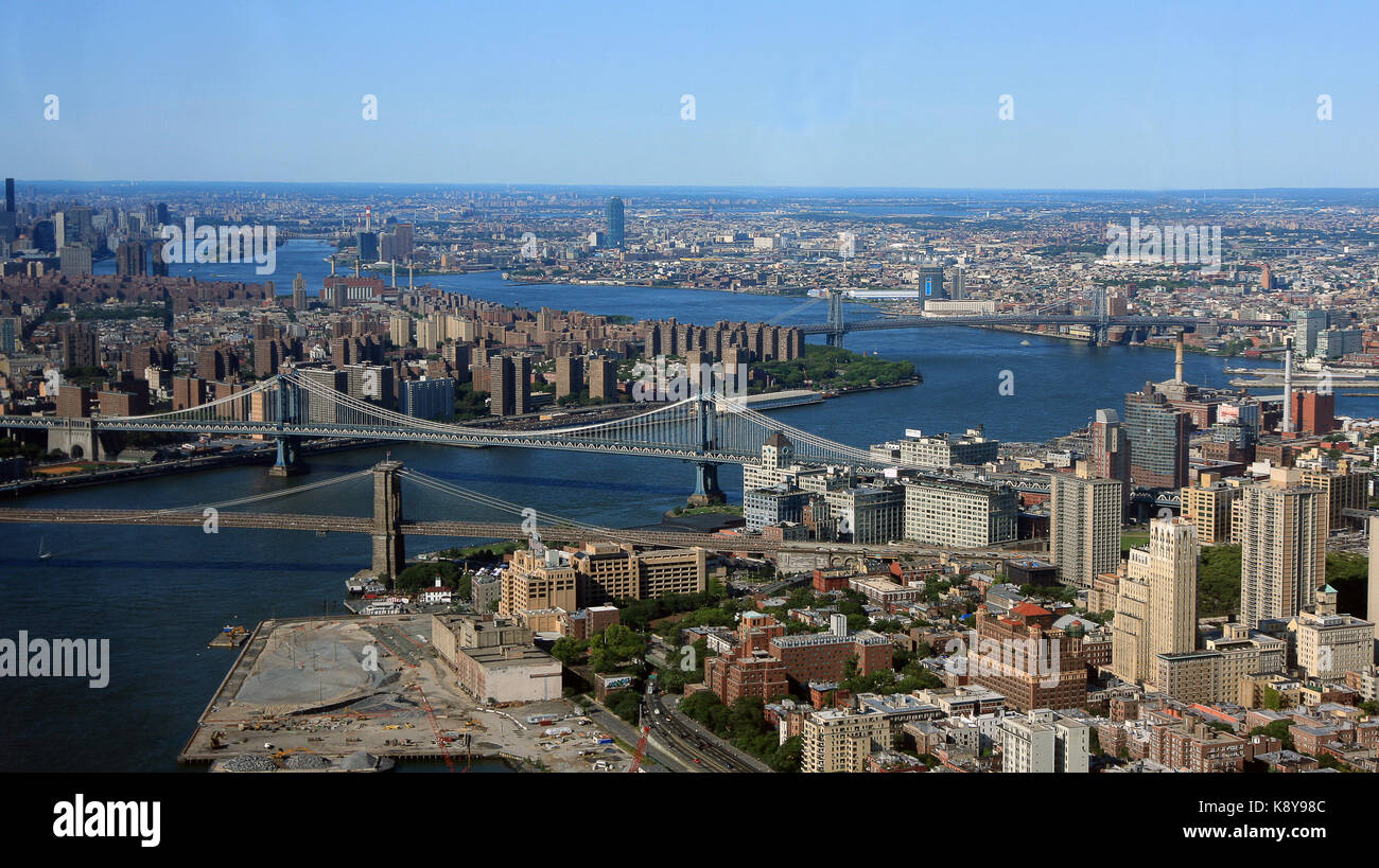 Aerial view of New York City with East River and Brooklyn, Manhattan, Williamsburg and Queensboro bridges visible. - Stock Image